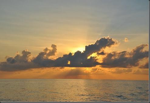 sunset open ocean circumnavigating by sailboat 3