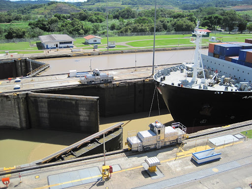 One of the lock doors opening at Miraflores Locks.  In the distant lane you can see the height of this lock when full.
