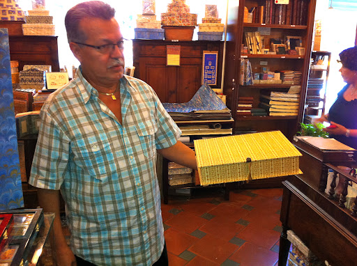 Owner John Leon showed me one of his most popular items, a beautiful box for storing wedding invitations, photos, or prized trickets.