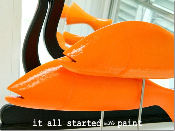 fish_painted_bright_orange_on_sticks