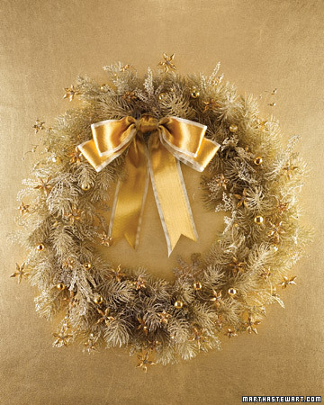 Golden beads become jewel-like decorations for a Christmas wreath. The beadwork flowers have wavy wire stems (they get their shape when the wire is wrapped around a spool).