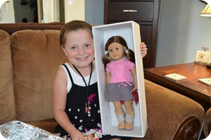 With her look-alike American Girl doll