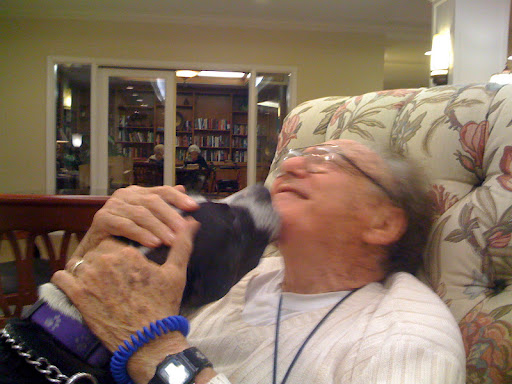 Don Meyer receiving lots of love from a visiting pooch!