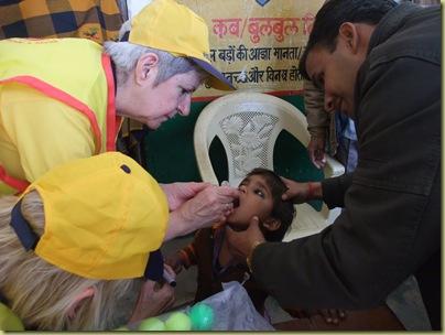Pat administering vaccine