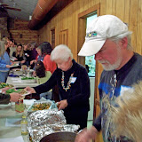 RAVS members Ellie and David serve up the evenings banquet. January 2008