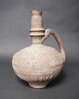 Large Ewer Greater Iran (Afghanistan) Large Ewer, 12th-14th century Ceramic; Vessel, Fritware, molded, Height: 12 1/4 in. (31 cm); Diameter: 7 1/2 in. (19 cm) Gift of Kate Fitz Gibbon and Andrew Hale (AC1997.253.3) Art of the Middle East: Islamic Department.