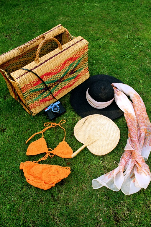 1. A woven beach basket is my luggage of choice when heading on a beach hol.                                                               2. I never leave without my Diana + Lomography camera                                                                                               3. I adore this black 70s floppy sun hat, it's the chicest beach hair cover-up.                                                                    4. I always tie a large scarf around my floppy hat and this cream and paisley chiffon number works just as well as a sarong or wrap.                                                                                                                                                                     5. I seem to have amassed a little collection of wooden and woven fans over the years. They come in very handy whilst lying in the sun and needing a little cooling breeze.                                                                                                               6. Next up is a Hot-to-trot bikini. I love bright punch colours and almost always go for a block colour two piece. This gorgeous crochet 60's bikini is bang on trend for SS11 and is now available on Bird On A Wire Vintage at ASOS Marketplace.
