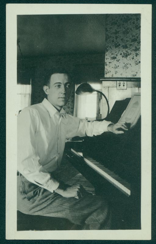 W. Dorr Legg, here sitting at a piano, was a 1928 graduate from the University School of Music, Ann Arbor. Undated.