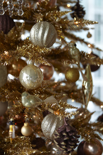 I also mixed in some cream-colored ornaments with the silver and gold.