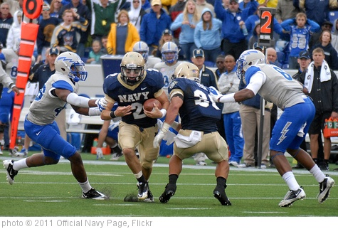'Navy quarterback Proctor breaks tackle during game against Air Force' photo (c) 2011, Official Navy Page - license: http://creativecommons.org/licenses/by/2.0/