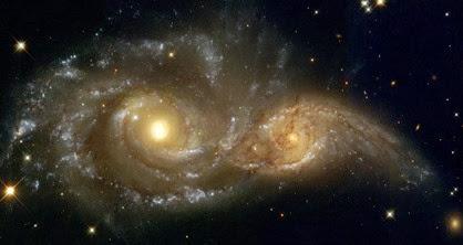 galáxias NGC 2207 e IC 2163