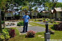 Hubby standing on a camping site and amidst the camp houses in Camp@Tagan Lake Mirror and Hillside