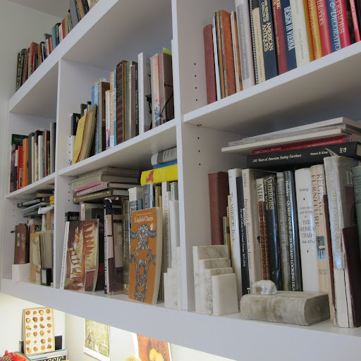 Fritz's bookshelves are filled to the brim with books on history and collecting.