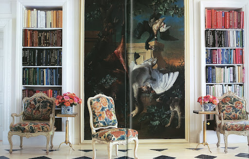 The floor-to-ceiling painting is by Jean-Baptise Oudry. Again, Roehm's bookshelf arrangement is so pleasing to the eye–it reminds me of the shelves in my own office.