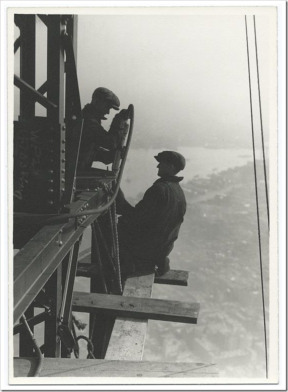 Two-workers-riveting-a-corner-beam-1931