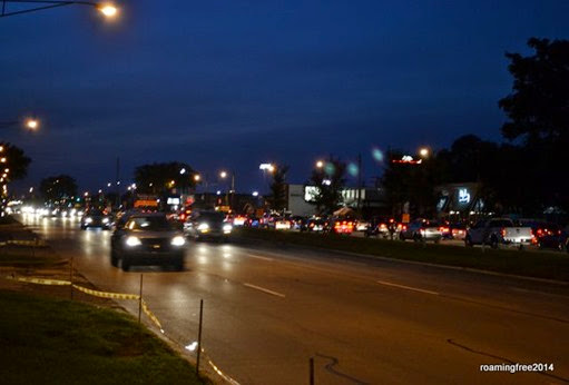 Lots of cars lining Woodward Avenue