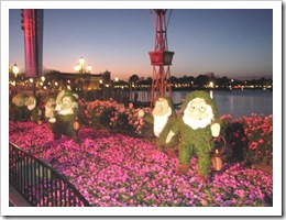 Florida vacation Epcot topiary 7 dwarfs at dusk