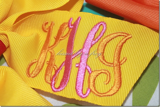 interlock monogram boutique bow kissed by a frog font detail