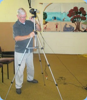 Gordon Sutherland preparing the video camera for use with the Big Screen. Photo courtesy of Dennis Lyons.