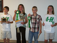 Judge's Choice Junior Presentation trophy was awarded to David Hora of Jackson Jets 4-H Club.  Amanda Pfeifer of the Riverside Ramblers and Richard Dunbar of the Bows & Bullets Shooting Sports 4-H club were selected from the junior division to represent Washington County at the State Fair.  Emily Hora of the Jackson Jets was selected as the State Fair alternate.  All junior presenters received participation ribbon and premium money.  Photo Courtesy of the Washington County Extension.