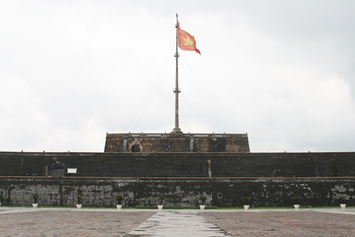 The Vietnamese flag flying high over the Hue citadel.