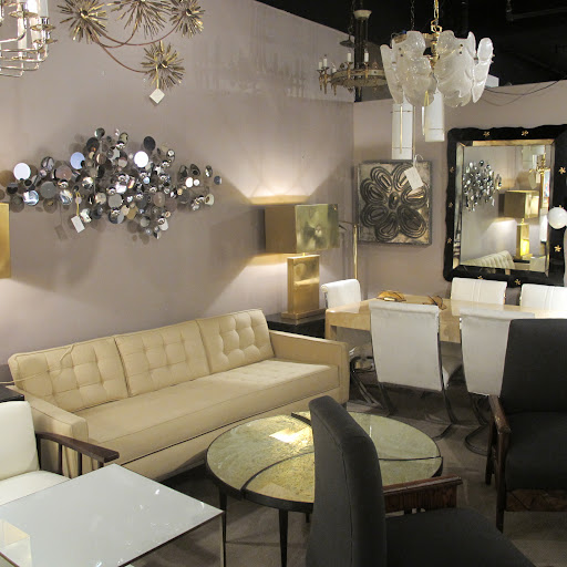 I like the neutral couch. This dealer's selection of lighting fixtures and wall art are especially great as well.