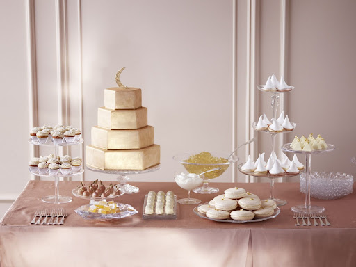 Standing tall over this dessert bar is a golden cake covered in fondant and brushed with luster dust. (Martha Stewart Weddings)