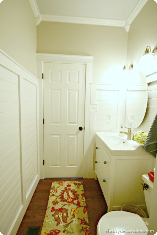 bathroom with planked walls