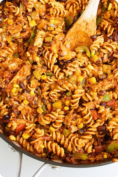 Cheesy Tex-Mex Chicken Pasta Skillet – All the flavors of a hearty chili and the comfort of a pasta dish! So easy and delish! | thecomfortofcooking.com
