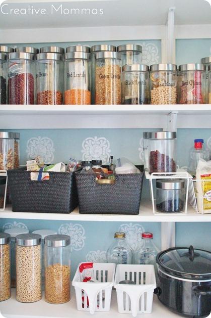 organized pantry with barn door
