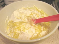 2 ingredient cans lemon filling and cake mix mixing in bowl
