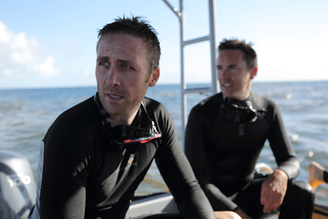 Philippe Cousteau and a team of marine conservationists dive off the Great Barrier Reef, Australia, featured in CNN's portfolio of environmental programming, 'Going Green: Oceans'. Photo: CNN