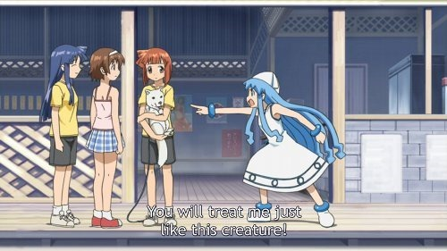 Three girls stand on the porch of the beach cafe, one holding a puppy, as Squid Girl points at them accusingly