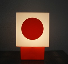 white lamp with orange base and orange dot