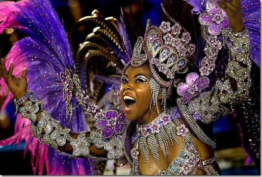 A performer from the Renascer de Jacarepagua samba school dances at the Sambadrome in Rio de Janeiro. (Silvia Izquierdo/Associated Press)