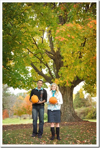 under tree with pumpkins
