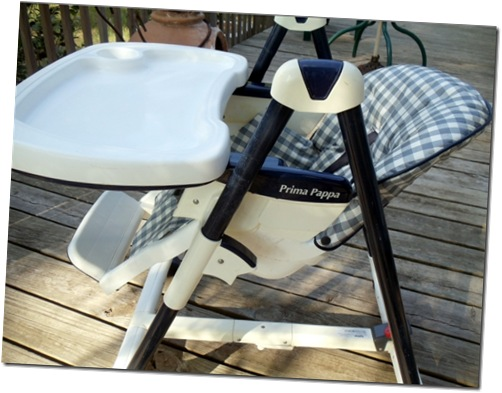 high chair in lower and  slanted new born position
