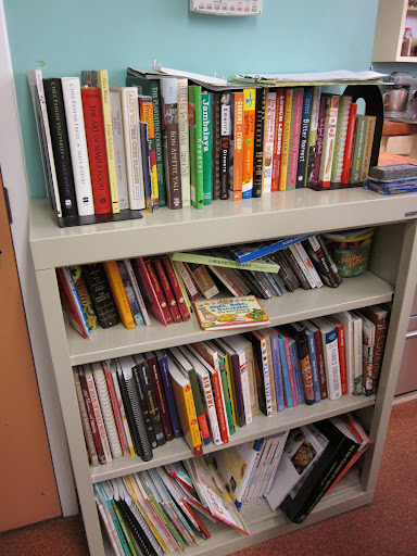 A case of cookbooks provides inspiration for new recipes and helps students learn about unfamiliar cuisines.