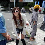 Japanese girl wearing white shades on Jingu bridge in Harajuku, Tokyo, Japan