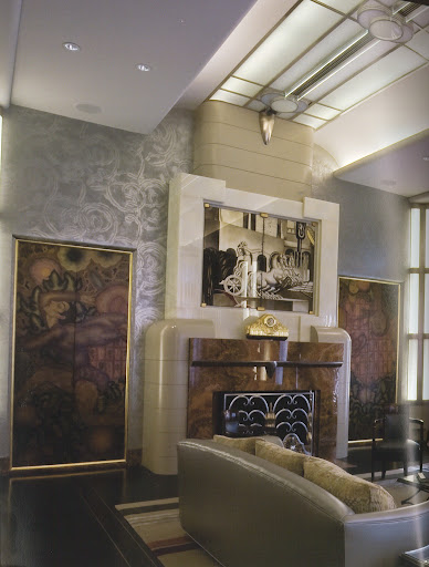The modern double-height living room of Chicago collector Richard Driehaus features spectacular decorative panels by Josef Urban from the Ziegfeld Theater and a 1939 wrought-iron grill by Arbus and Raymond Subes. (Regency Redux, Rizzoli)
