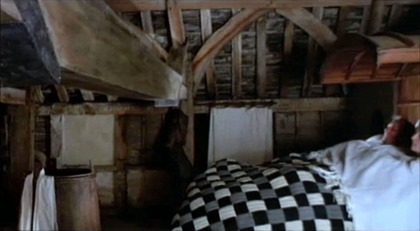 Carpenter John and Alison under a checkered quilt (The Miller's Tale)