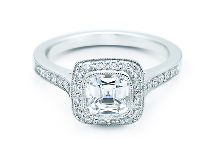 The Tiffany Legacy features a cushion modified brilliant cut diamond in a lavish diamond-encrusted setting. We adore its vintage feel.
