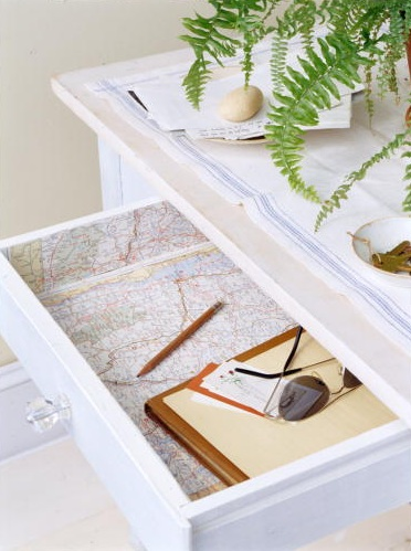 Maps inside of a drawer is an unexpected detail. (Martha Stewart Living, August 2002)