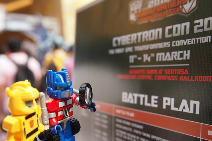Optimus Prime and Bumblebee inspecting Battle Plans