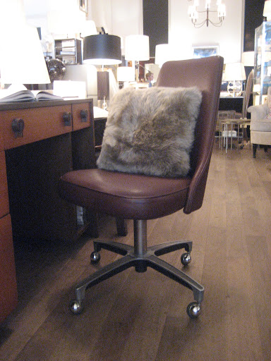 Mid-century swivel chair with faux pillow.