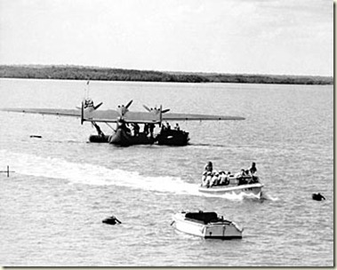 A Dutch crew from a visiting Dornier Do 24 flying boat in Roebuck Bay being taken into Broome by launch