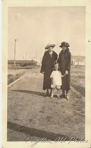 Ladies in hats and little girl with no coat Moorhead Ant