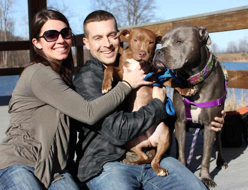 Proud parents and their adopted pitt bull kids. Lincoln and  Izzie are the best of friends and go everywhere with their mom and dad. These love-a-bulls were rescued and adopted through rescue-a-bull.org!