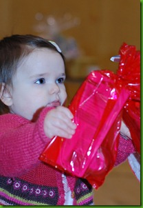 toddler with presents