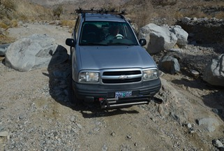 squeezing through the boulders in berdoo canyon
